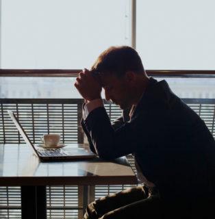 Depressed employee with laptop